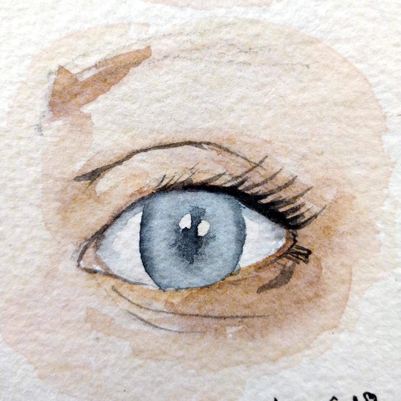 un oeil humain détaillé à l'aquarelle